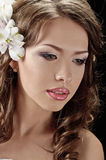 Fascination bride. Portrait of beautiful bride with flowers in hair on black Stock Photos