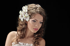 Fascination bride. Portrait of beautiful bride with flowers in hair on black Royalty Free Stock Images