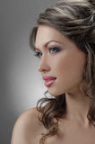 Fascination bride. Portrait of beautiful bride with flowers in hair on grey Stock Photography