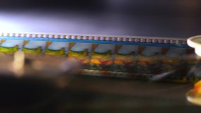 The fascination of cinema - 35mm film projected in a movie theater
