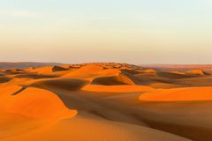 Fascination desert. Sultanate Oman - Endless expanse featuring the fascinating sand and gravel deserts - a varied rhythm of white beaches and steep cliffs, the Royalty Free Stock Photo