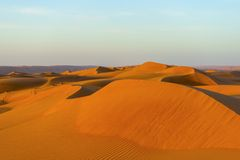 Fascination desert. Sultanate Oman - Endless expanse featuring the fascinating sand and gravel deserts - a varied rhythm of white beaches and steep cliffs, the Stock Photo