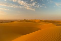 Fascination desert. Sultanate Oman - Endless expanse featuring the fascinating sand and gravel deserts - a varied rhythm of white beaches and steep cliffs, the Royalty Free Stock Image
