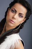 Fascination. Face of Young Nice Looking Brunette with Earrings Royalty Free Stock Photography