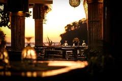 Fascination. Sunset light in the beach restaurant Stock Image