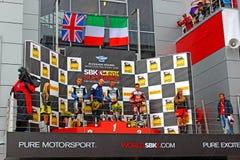 Fase do campeonato mundial do Superbike, cerimônia de entrega dos prêmios do russo, pódio, o 21 de julho de 2013, no canal adutor  Imagens de Stock Royalty Free