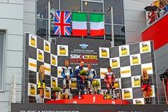 Fase do campeonato mundial do Superbike, cerimônia de entrega dos prêmios do russo, pódio, o 21 de julho de 2013, no canal adutor  Foto de Stock Royalty Free