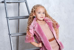 Fashio Child In Pink Dress And Fur Coat Stock Photos