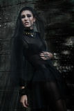 Fashiom model dressed in gothic style. Vamp. Fashiom model dressed in gothic dark style. Vamp Royalty Free Stock Photo