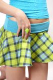 In fashion 01. Young girl with blue and green skirt and green plastic ring Stock Photos