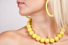 In fashion 04. Young girl with yellow earings and necklace Royalty Free Stock Images