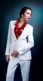Fashion. Beautiful fashion girl in white suit and red details Stock Photos