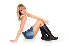 Fashion. Young blond girl sitting on the floor Stock Photography