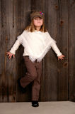 Fashion. A young girl standing in front of a wall royalty free stock photos
