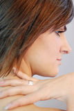 Fashion. Close up of female fingers over neck Royalty Free Stock Photo