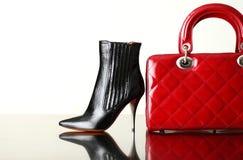 Fashion. Black shoe and red handbag royalty free stock image