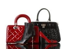 Fashion. Shoes and handbag on white background stock images