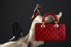 Fashion. Shoes and handbag composition on dark background royalty free stock photography