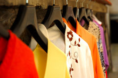 Fashion. Clothes on clotheshanger in the shop Stock Images