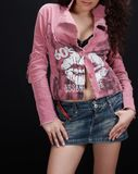 Fashion. Young girl with jeans skirt an pink jacket stock photo