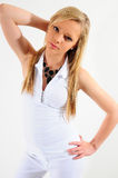 Fashion. Young female model standing aginst a white back ground holding her long hair back Royalty Free Stock Photography