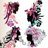 Fashion abstract female face silhouettes with floral hairstyle. Set of vector abstract faces of girls with floral hair style Royalty Free Stock Image