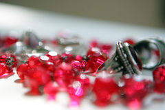 Fashion accessories. Ruby chain and the silver ring on the white table royalty free stock images
