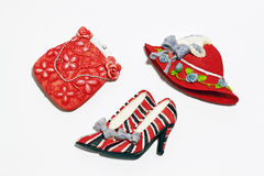 Fashion accessories. An image of a toy hat, bag & high-heel shoes stock photography