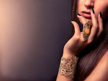 Fashion accessories. Charming hand with golden accessories and jewelry Royalty Free Stock Photos