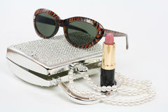 Fashion Accessories. Sunglasses, purse, pearls and lipstick create a retro look Stock Images