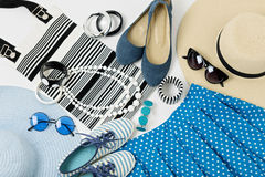 Fashion accessories in black and white and blue colors - hat clothing, shoes and bag, bracelets and glasses. stock photos