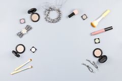Fashion accessories, makeup products, jewelry and handbag on pastel background. Beauty and fashion concept, flat lay royalty free stock photography