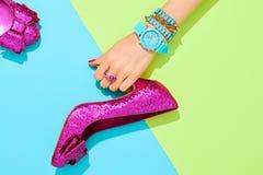 Fashion Accessories Set. Outfit. Minimal Style. Fashion. Clothes Accessories fashion Set. Female hand Stylish Trendy heels, Glamor Wrist Watches. Summer fashion Stock Image