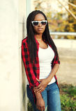 Fashion african woman wearing a red checkered shirt and sunglasses Royalty Free Stock Photography