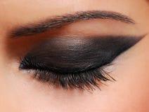 Fashion arrow. Long woman eyelashes brushing black mascara Stock Photography