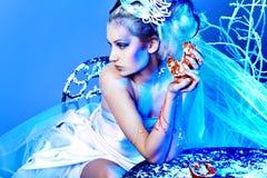 Fashion art. Art portrait of a beautiful female model over snowy background. Fashion, beauty stock photos