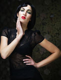Fashion art girl portrait.Vamp style. Glamour vampire woman. Studio shot Stock Photos