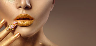 Fashion art golden skin woman face portrait royalty free stock images