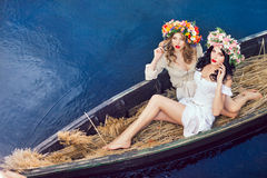 Fashion art photo of a beautiful girls in boat Stock Photography