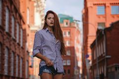 Fashion art photo. Portrait of woman with long red hair, in the city. Fashion art photo. Portrait of woman with long red hair, outdoors royalty free stock images