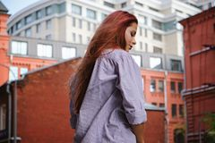 Fashion art photo. Portrait of woman with long red hair, in the city. Fashion art photo. Portrait of woman with long red hair, outdoors royalty free stock photo