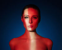 Fashion art portrait of elegant naked young woman. With color light on her face Royalty Free Stock Photography