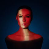 Fashion art portrait of elegant naked young woman. With color light on her face Stock Image
