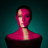 Fashion art portrait of elegant naked young woman. With color light on her face Royalty Free Stock Photo