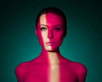 Fashion art portrait of elegant naked young woman. With color light on her face Stock Photo