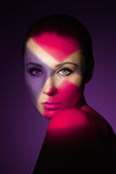 Fashion art portrait of elegant naked young woman. With color light on her face Stock Photos