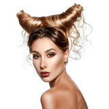 Fashion art portrait of beautiful woman with horns. Fantasy Hairstyle stock images