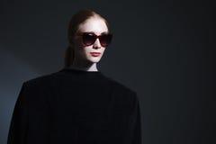 Fashion art studio portrait of elegant girl in geometric black a Stock Photography