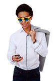 Fashion asian man in sunglasses using smarthone Stock Images