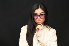 Fashion asian model woman in sunglasses in studio Royalty Free Stock Photo